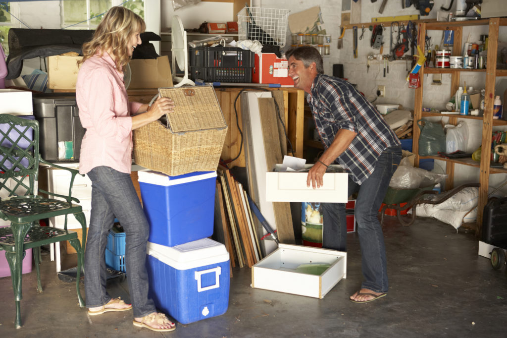 A couple preparing their belonging from the garage for spring clean self storage.