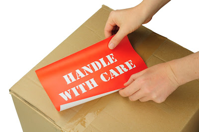 box with text handle with care