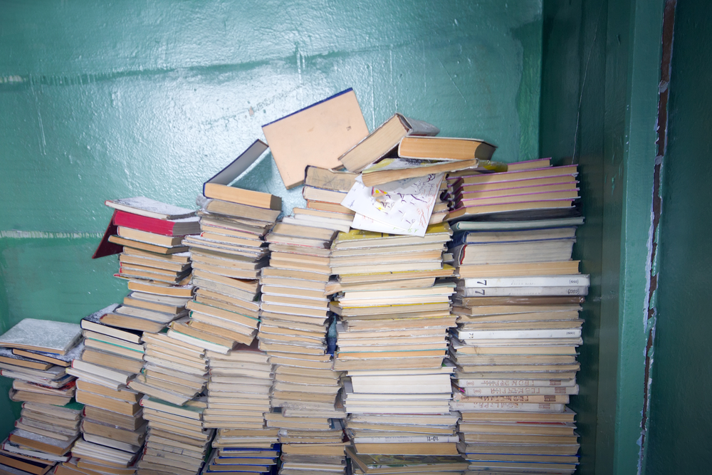 Personal student storage solutions by Boylin's Self Store - Ppile of books at a wall forgotten and left